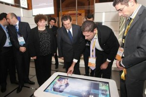 Telecom Minister Boutros Harb checking a booth at the Arabtech fair, the accompanying exhibition for the ArabNet Beirut.
